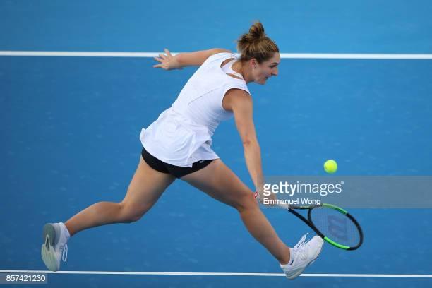 Gabriela Dabrowski of Cananda return a shot during her doubles match with Yifan Xu of China against Raluca Olaru of Romania and Lyudmyla Kichenok of...