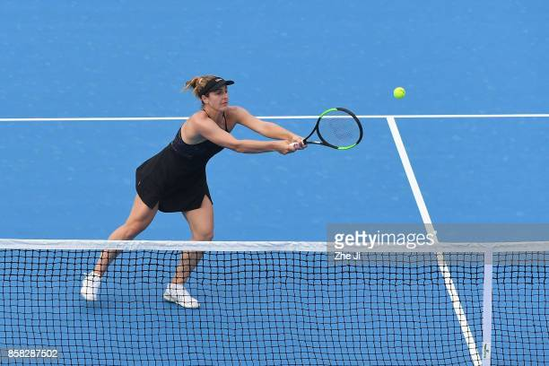 Gabriela Dabrowski returns a shot against YungJan Chan of Chinese Taipei and Martina Hingis of Switzerland during their Women's Doubles Quarterfinals...