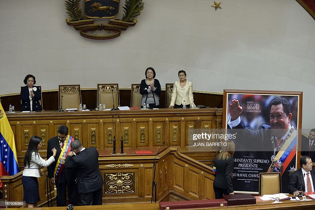 Gabriela (L), daughter of deceased Venezuelan president Hugo Chavez and Assemby President Diosdado Cabello (R) adjust the presidential sash of President Nicolas Maduro during his inauguration in Caracas, on April 19, 2013. .