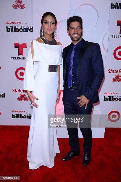 Gabriela Isler and David Chocarro poses backstage at the 2014 Billboard Latin Music Awards at Bank United Center on April 24 2014 in Miami Florida
