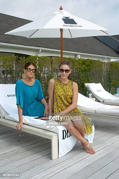 Gabriela Isler and Nia Sanchez at the Disaronno Summer Camp>> on July 27 2014 in Southampton New York