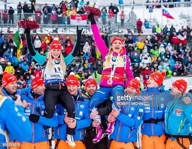Gabriela Koukalova of Czech Republic and Eva Puskarcikova of Czech Republic celebrate after the women's 125 km mass start race of the IBU Biathlon...