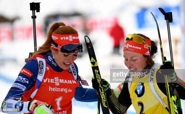Gabriela Koukalova of Czech Republic is congratuled by Laura Dahlmeier of Germany after the women's 10km pursuit competition during the 2017 IBU...