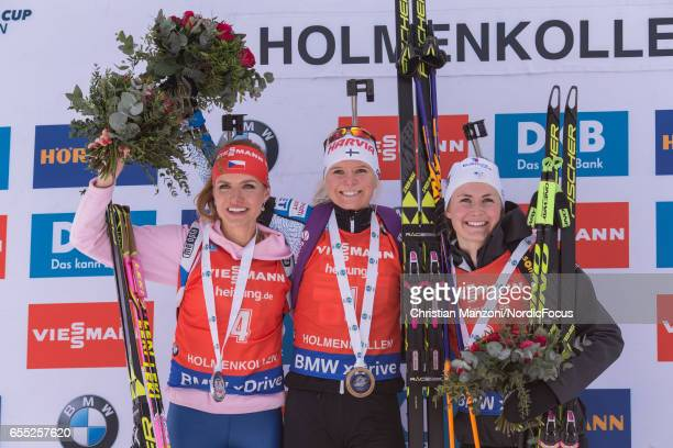 Gabriela Koukalova of the Czech Republic Mari Laukkanen of Finland Justine Braisaz of France celebrate after the 10 km women's Pursuit on March 18...