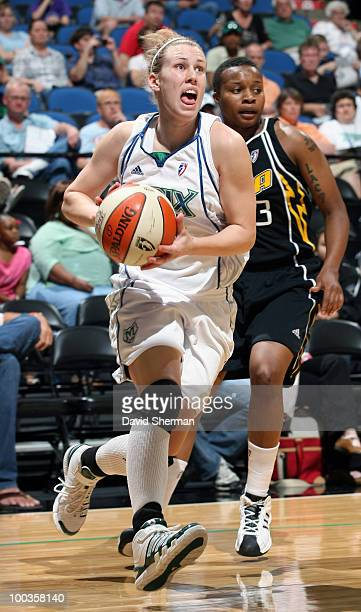 Gabriela Marginean of the Minnesota Lynx drives to the basket against Natasha Lacy of the Tulsa Shock during the game on May 23 2010 at the Target...