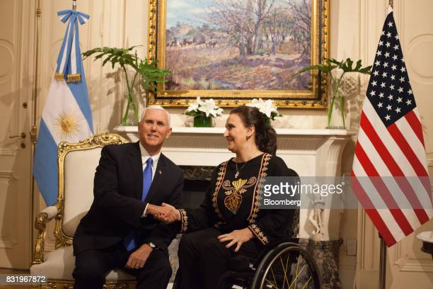 Gabriela Michetti Argentina's vice president right shakes hands with US Vice President Mike Pence during a meeting at the Presidential Palace in...