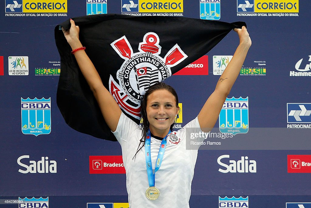 Gabriela Rocha stands on the podium for girls 200m butterfly Junior 2 during Julio Delamare Trophy at Botafogo Aquatic Park on December 07, 2013 in Rio de Janeiro, Brazil.