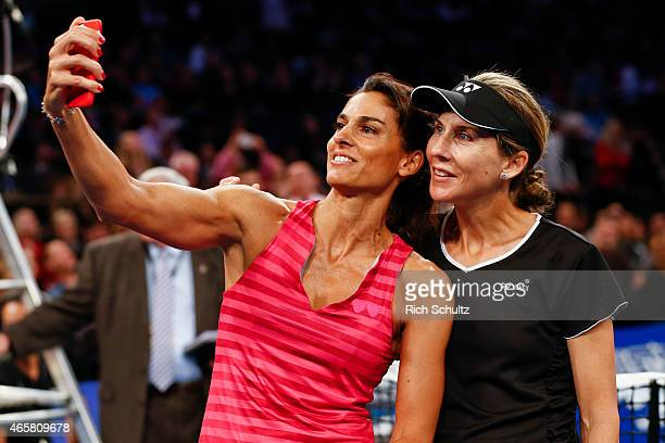 Gabriela Sabatini of Argentina and Monica Seles of the United States pose for a selfie during the BNP Paribas Showdown at Madison Square Garden on...