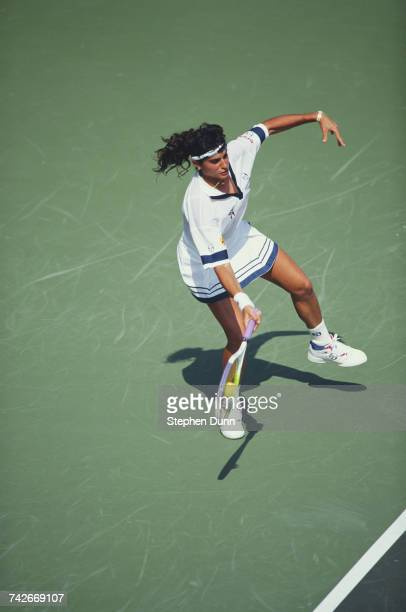 Gabriela Sabatini of Argentina makes a forehand return to Martina Navratilova during their Women's Singles Semi Final match at the Virginia Slims of...