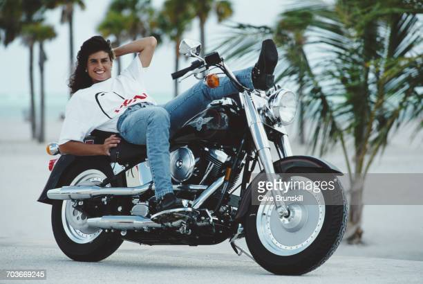 Gabriela Sabatini of Argentina poses for a portrait aboard a HarleyDavidson Fatboy FLSTF motorcycle during the ATP Lipton Tennis Championship on 15...