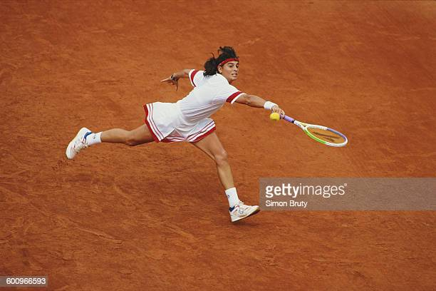 Gabriela Sabatini of Argentina reaches for a return during the Women's Singles Quarter Final match against Mary Joe Fernandez at the French Open...