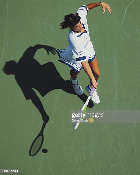 Gabriela Sabatini of Argentina returns a shot to Linda Harvey Wild during their Women's Singles match at the US Open Tennis Championship on 1...