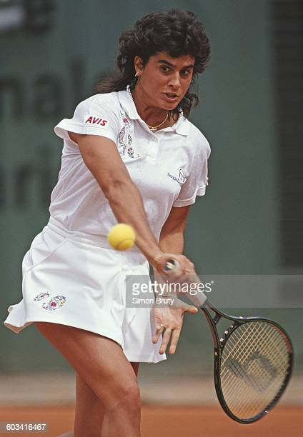 Gabriela Sabatini of Argentina returns against Jana Novotna during their Women's Singles fourth round match at the French Open Tennis Championship on...