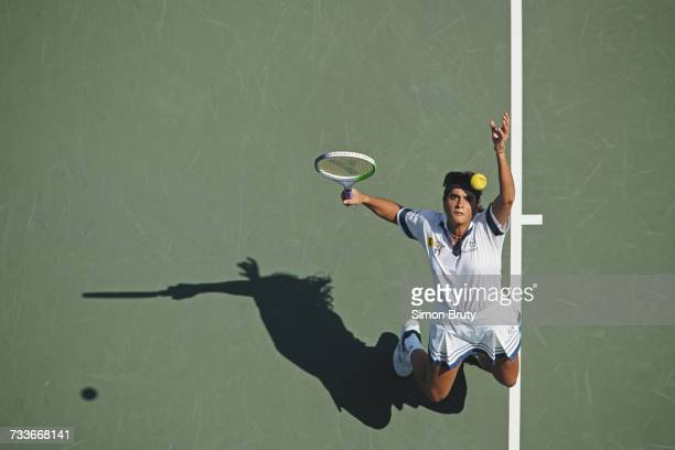 Gabriela Sabatini of Argentina serves to Linda Harvey Wild during their Women's Singles first round match of the US Open Tennis Championship on 1...