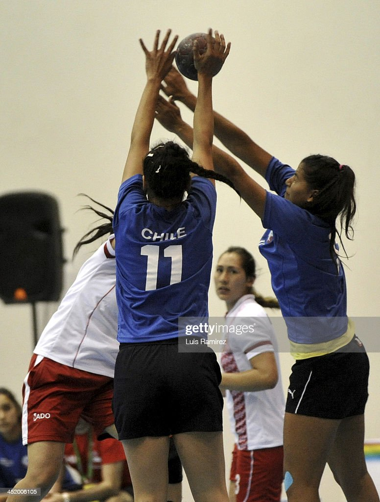 Gabriela Santibañez of Peru vies for the ball with Francisca Zavala of Chile during a match between Peru and Chile in Women's handball as part of the XVII Bolivarian Games Trujillo 2013 at Colegio San Agustin on November 25, 2013 in Chiclayo, Peru.