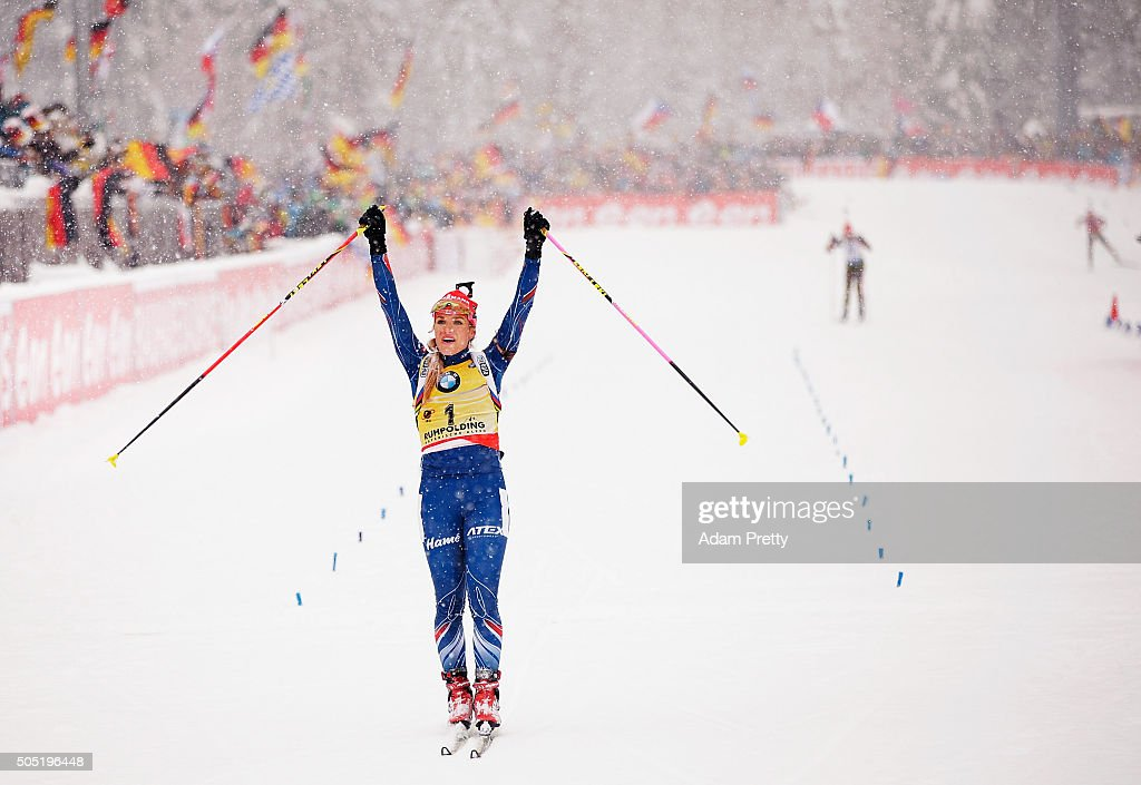 Gabriela Soukalova of the Czech Republic celebrates as she crosses the finish line to claim victory in the Women's 12.5km Biathlon race of the Ruhpolding IBU Biathlon World Cup on January 16, 2016 in Ruhpolding, Germany.