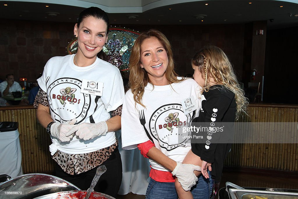 Gabriela Vergara and Geraldine Bazan participate in 5th Annual Thanksgiving Feed A Friend at Bongos on November 22, 2012 in Miami, Florida.
