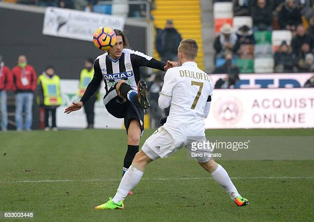 Gabriele Angella of Udinese Calcio competes with Gerard Deulofeu of AC Milan during the Serie A match between Udinese Calcio and AC Milan at Stadio...