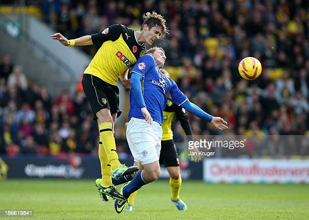 Gabriele Angella of Watford competes for the arial ball with Chris Wood of Leicester City during the Sky Bet Championship match between Watford and...