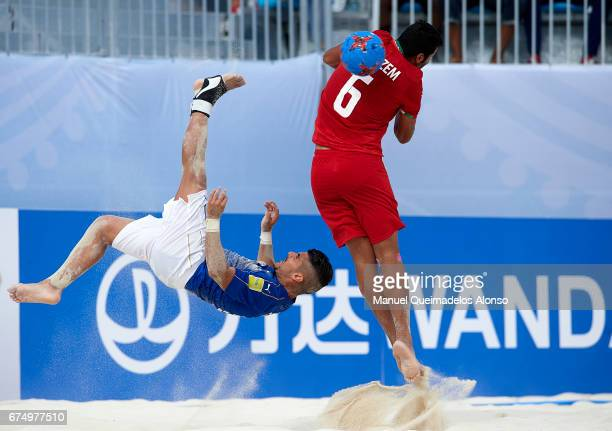 Gabriele Gori of Italy attempts a scissor kick shot on goal in front Seyed Ali Nazem of Iran during the FIFA Beach Soccer World Cup Bahamas 2017...
