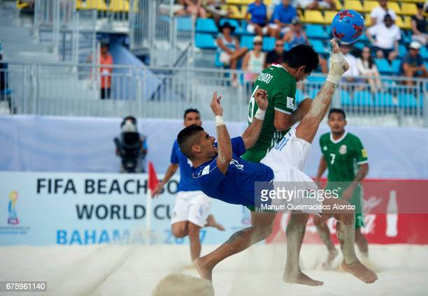 Gabriele Gori of Italy attempts a scissor kick shot on goal in front Gonzalo Pichardo of Mexico during the FIFA Beach Soccer World Cup Bahamas 2017...