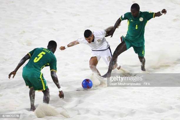 Gabriele Gori of Italy battles for the ball with Papa Ndour and Mamadou Sylla of Senegal during the FIFA Beach Soccer World Cup Bahamas 2017 quarter...