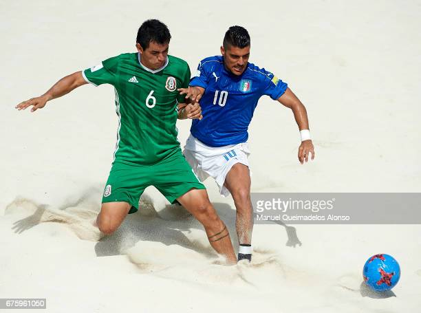 Gabriele Gori of Italy competes for the ball with Gonzalo Pichardo of Mexico during the FIFA Beach Soccer World Cup Bahamas 2017 group B match...