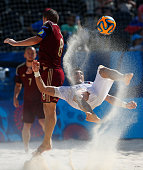 Gabriele Gori of Italy is challeneged by Ilia Leonov of Russia during the Men's Beach Soccer gold medal match between Italy and Russia on day sixteen...