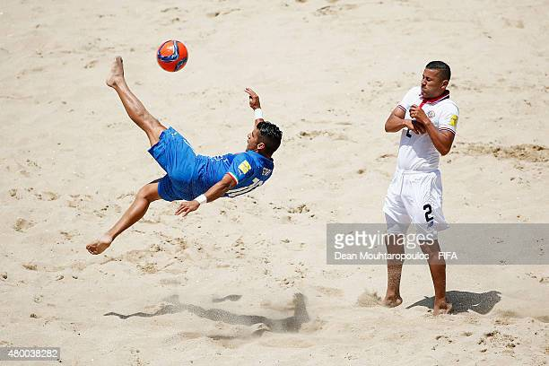Gabriele Gori of Italy shoots on goal in front of Andres Villegas of Costa Rica during the Group B FIFA Beach Soccer World Cup match between Italy...