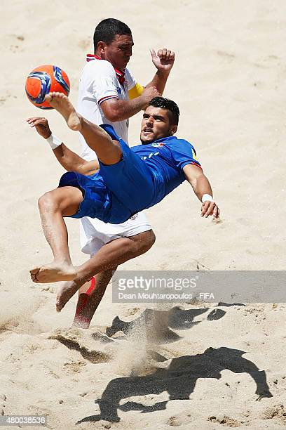 Gabriele Gori of Italy shoots on goal in front of Jose Mendoza of Costa Rica during the Group B FIFA Beach Soccer World Cup match between Italy and...