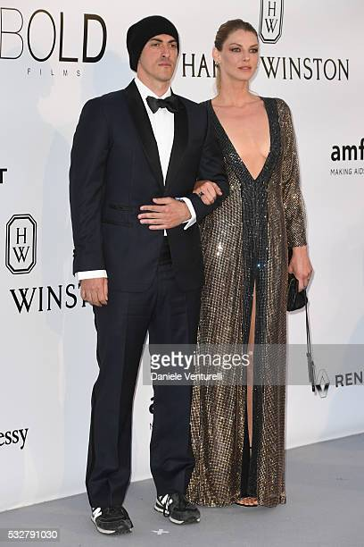 Gabriele Moratti and Angela Lindvall attend the amfAR's 23rd Cinema Against AIDS Gala at Hotel du CapEdenRoc on May 19 2016 in Cap d'Antibes France