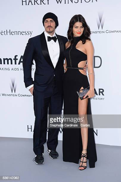 Gabriele Moratti and Isabeli Fontana attends the AmfAR Red Carpet during the 68th Cannes Film Festival on May 21 2015 in Cannes France