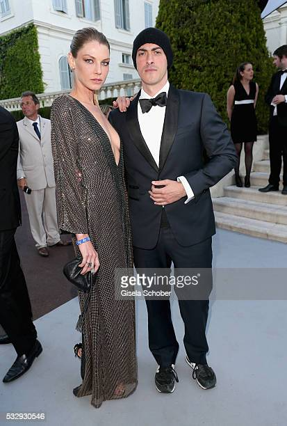 Gabriele Moratti and model Angela Lindvall attend the amfAR's 23rd Cinema Against AIDS Gala at Hotel du CapEdenRoc on May 19 2016 in Cap d'Antibes...