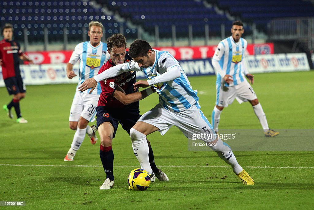 Gabriele Perico of Cagliari and Marco Capuano of Pescara (R) vie for the ball during the TIM Cup match between Cagliari Calcio and Pescara at Stadio Is Arenas on December 5, 2012 in Cagliari, Italy.