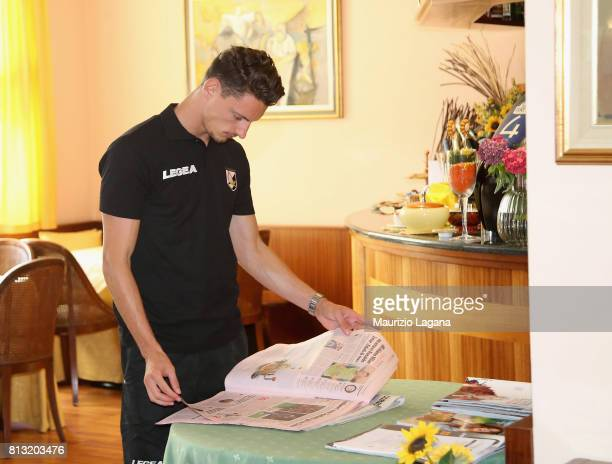 Gabriele Rolando of Palermo reads a newspaper on July 12 2017 in Gradisca d'Isonzo Italy