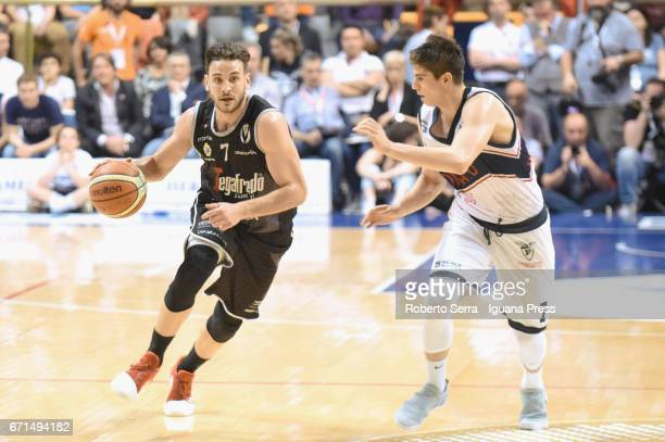 Gabriele Spizzichini of Segafredo competes with Leonardo Candi of Kontatto during the LegaBasket LNP of serie A2 match between Fortitudo Kontatto...