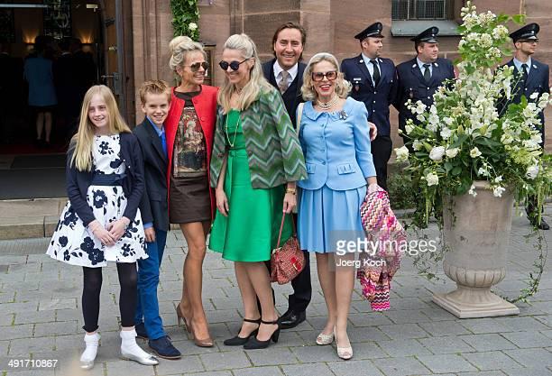 Gabriele zu CastellRuedenhausen her daughters Georgi and Susanne her husband Bernd and children arrive at MartinLutherChurch on May 17 2014 in Stein...
