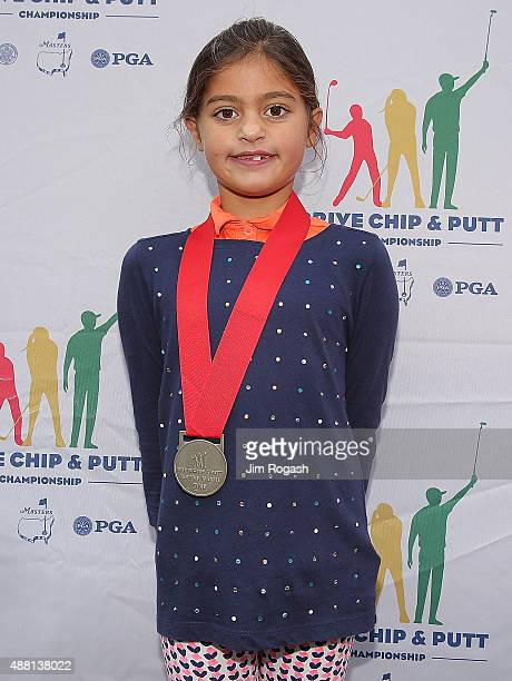 Gabriella DeGasperis first place winner in the Girls 79 Chipping Competition poses with her medal during the 2015 Drive Chip and Putt Championship at...