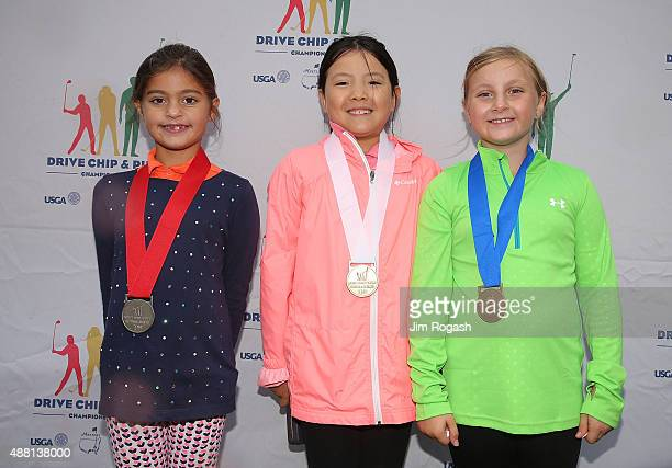 Gabriella DeGasperis second place winner Sarah Shao third place winner and Gianna Papa first place winner in the Girls 79 Overall Competition pose...