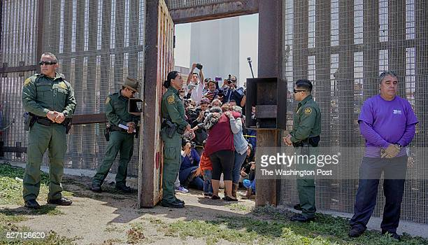 Gabriella EsperanzaMback facing hugs her Mother and Sister after Customs and Border Patrol agents opened the fence during a Children's Day...