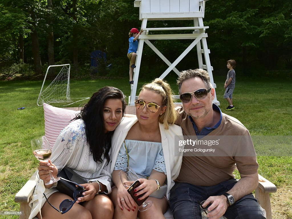 Gabriella Fernandez, Katie Fe Delane, and CEO of DuJour Media Jason Binn, attend as Jason Binn hosts his Annual Memorial Day Party with DuJour Media's Leslie Farrand and Moby's sponsored by Rolls-Royce and Empire CLS on May 29, 2016 in East Hampton.