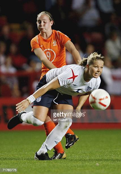 Gabriella Melis of the Netherlands tackles Rachel Unitt of England during Women's World Cup Qualifier match between England and Netherlands at the...