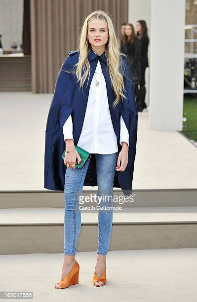 Gabriella Wilde wearing Burberry arrives at the Burberry Prorsum Autumn Winter 2013 Womenswear Show on February 18 2013 in London England