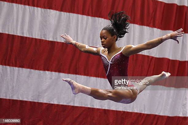 Gabrielle Douglas competes on the balance beam during the Senior Women's competition on day two of the Visa Championships at Chaifetz Arena on June 8...
