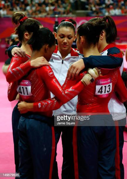 Gabrielle Douglas Mc Kayla Maroney Kyla Ross Jordyn Wieber and Alexandra Raisman of the United States huddle during the Artistic Gymnastics Women's...