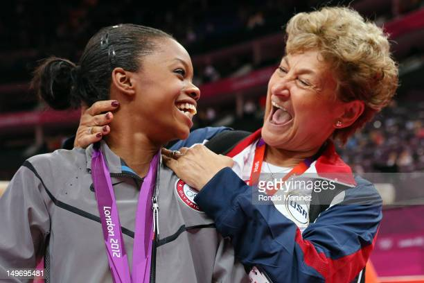 Gabrielle Douglas of the United States celebrates winning the gold medal with team coordinator Martha Karolyi after the Artistic Gymnastics Women's...