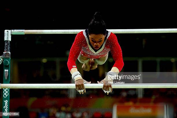 Gabrielle Douglas of the United States competes in the Women's Uneven Bars Final on Day 9 of the Rio 2016 Olympic Games at the Rio Olympic Arena on...