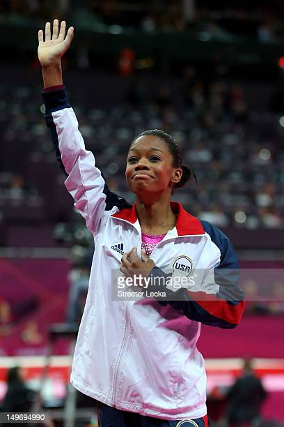 Gabrielle Douglas of the United States waves to the crowd after Douglas wins the gold medal in the Artistic Gymnastics Women's Individual AllAround...