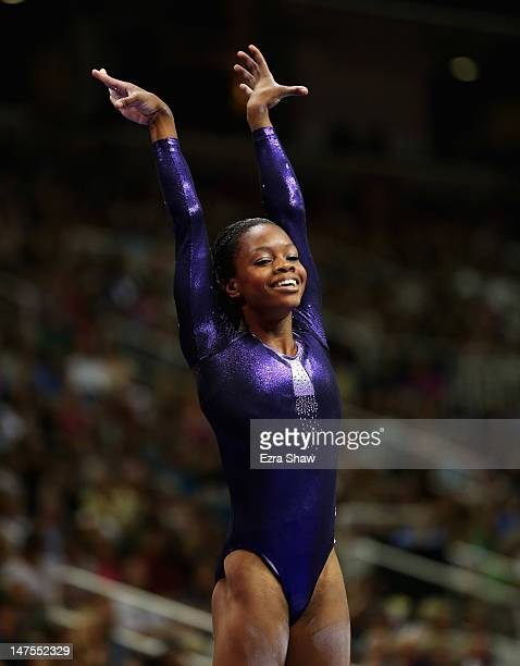 Gabrielle Douglas raises her hands after competing on the beam during day 4 of the 2012 US Olympic Gymnastics Team Trials at HP Pavilion on July 1...