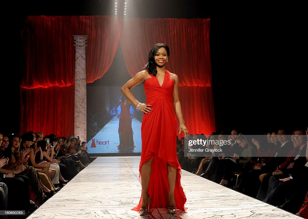 Gabrielle Douglas wearing Pamella Roland on the runway during The Heart Truth 2013 Fashion Show held at the Hammerstein Ballroom on February 6, 2013 in New York City.